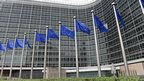 European flags in front of European Commission building