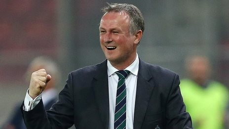 Northern Ireland manager Michael O'Neill shows his delight during his team's 2-0 win over Greece in Athens