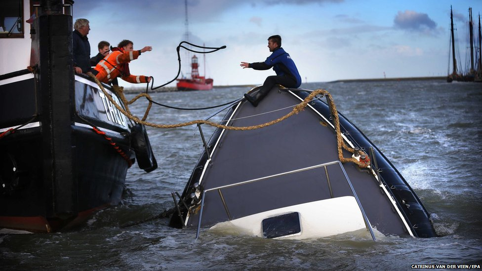 Rescuers try to save a sinking ship