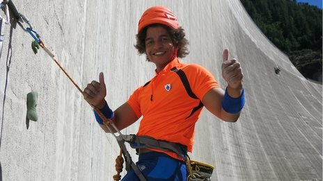Blue Peter's Radzi gives a thumbs up during a wall climb