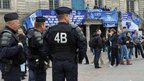 French riot police watch Everton supporters gathering in Lille