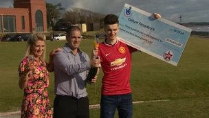 Callum Fitzpatrick holding cheque