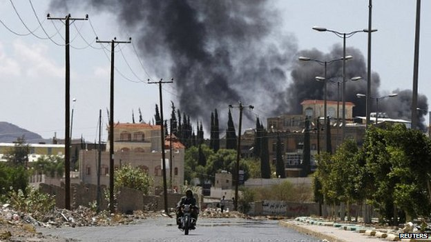 Smoke rises from an area where Shia Houthi rebels are fighting against government forces in Sanaa - 21 September 2014