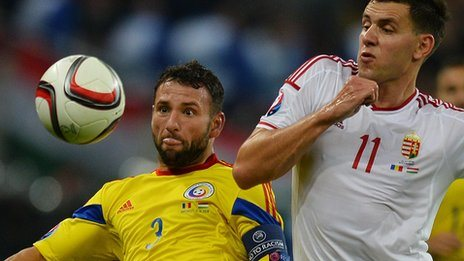 Romania defender Razvan Rat and Hungary's forward Adam Szalai compete for the ball during the Euro 2016 Group F qualifying match in Bucharest