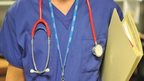 An NHS member of staff