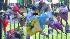 Flowers, toys, cards and notes are left at the scene where a 22-year-old mother-to-be Paige Jackson died