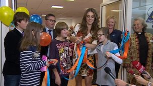 Liz Hurley opening Care in the High Street