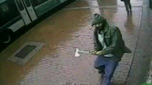 The attacker approaches the officers in Queens, in a photo released by New York police, 24 Oct