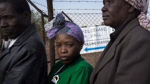 Residents queue to cast their ballots at a polling station in Serewe on 24 October 2014 for Botswana's general elections