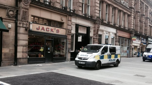 Police outside Jack's barbers in Newcastle