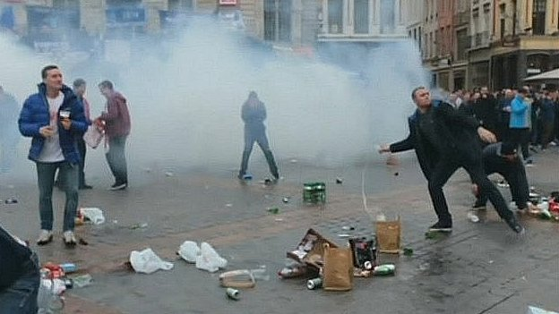 Everton fans throwing missiles in Lille