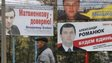 A man walks past election posters in Kiev, Ukraine on 23 October 2014
