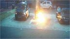 CCTV still of suspect starting fire at petrol garage in Greenwich