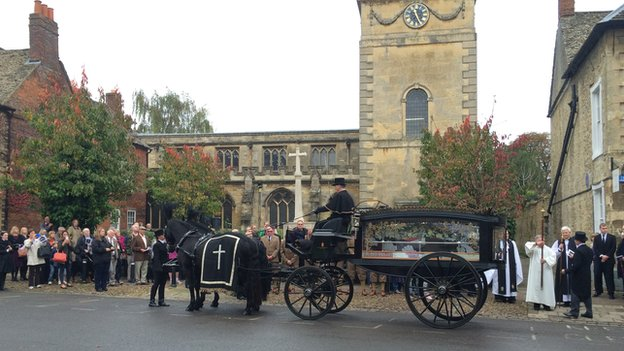 The funeral procession of the 11th Duke of Marlborough, John Spencer-Churchill, arrives at the Parish Church of St Magdalene, Woodstock