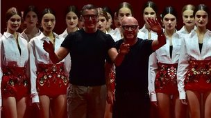 Domenico Dolce and Stefano Gabbana in front of models