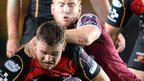 Elliott Dee is tackled by Rory Clegg