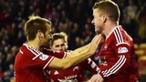 Niall McGinn and Jonny Hayes celebrate