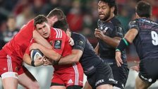 Munster's Ian Keatley is tackled