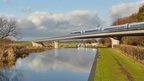 HS2 train travelling over viaduct (artist's image)