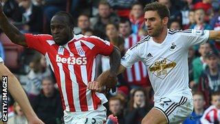 Stoke's Victor Moses and Swansea's Angel Rangel