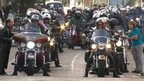 Motorcyclist ride through the centre of Norwich