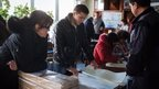 Election officials prepare ballot papers in Kramatorsk, in the government-controlled part of Donetsk region - 25 October