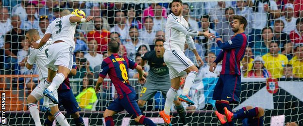 Real Madrid defender Pepe heads in his side's second goal against Barcelona