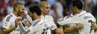 Real Madrid's players celebrate scoring against Barcelona