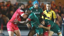 Vereniki Goneva of Leicester is tackled by Scarlets' Rory Pitman