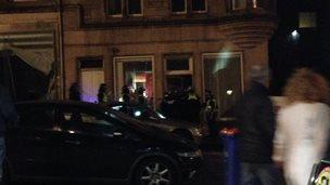 Police entering building in centre of Edinburgh on 25 October 2014