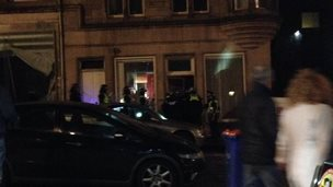 Police entering building in centre of Edinburgh on 25 October 2014