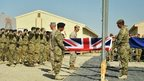Troops fold a union flag