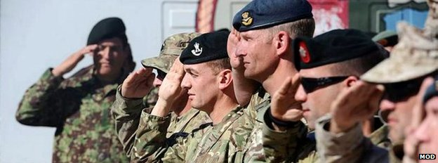 British soldiers saluting in a line