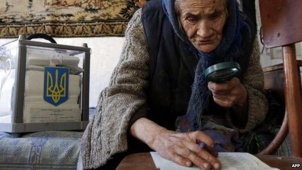 Elderly woman votes at home in village north of Kiev - 26 October