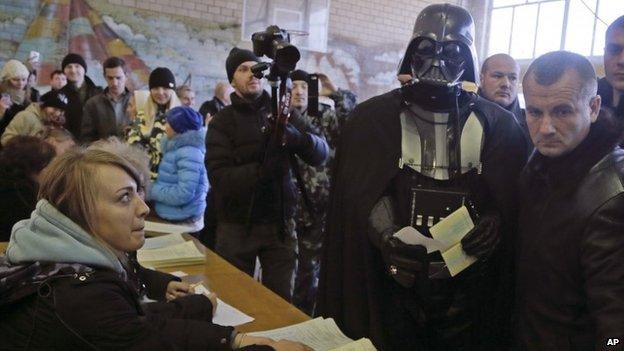Darth Vader, leader of Ukraine Internet Party, at polling station in Kiev - 24 October