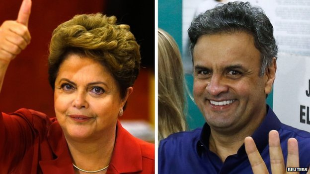 A combination photo shows Brazilian presidential candidates Dilma Rousseff (L) and Aecio Neves gesturing to photographers after voting in Porto Alegre (L) and Belo Horizonte on 26 October 2014.