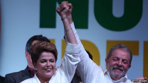 Dilma Rousseff celebrates with Brazil's former President Luiz Inacio Lula da Silva at a news conference in Brasilia, Brazil, Sunday, October 26, 2014
