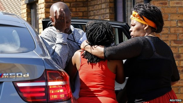 Family members of Kelly Khumalo in the township of Vosloorus, South Africa on 27 October 2014