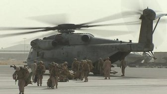Troops and helicopter