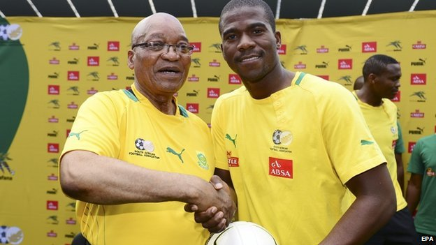 South Africa President Jacob Zuma (L) poses with Senzo Meyiwa (R) in Soweto, South Africa on 15 January 2013