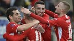 Cliftonville players celebrate going top of the Irish Premiership