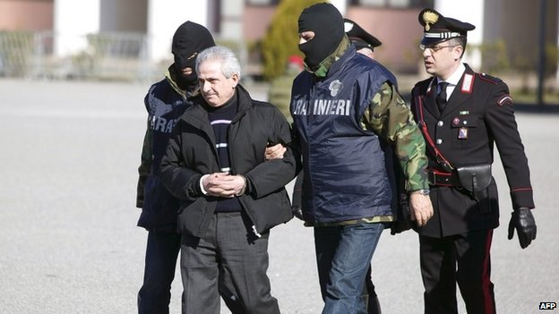 Italian special police escort one of Italy's most wanted bosses  Pasquale Condello (2nd L) following his arrest on February 2008