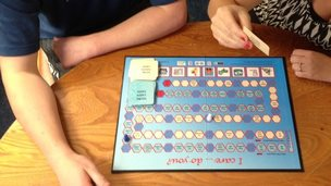 People playing the young carers' board game