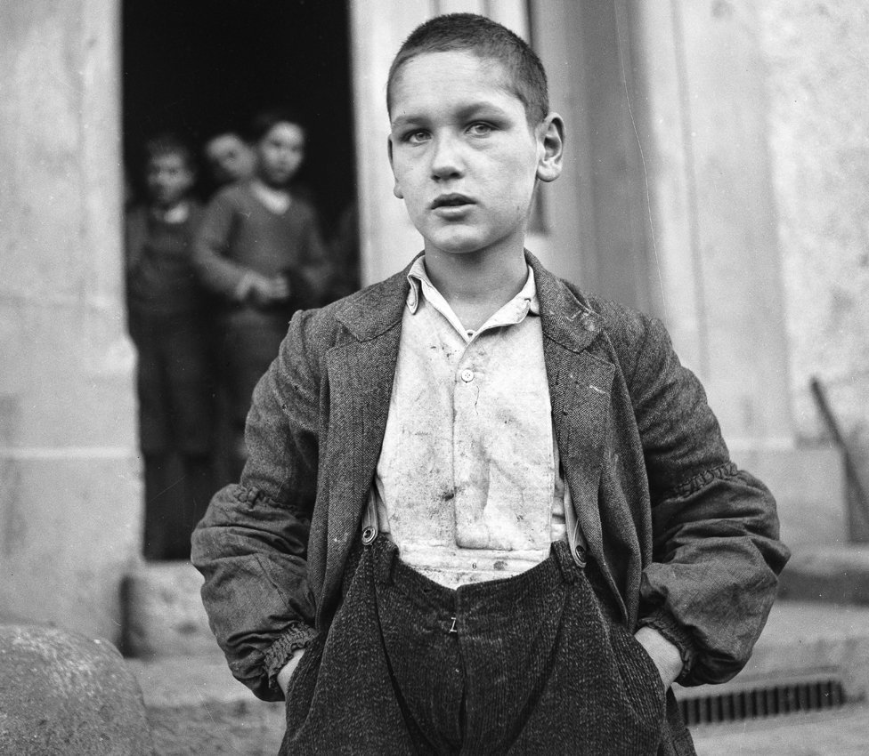 Archive photo of boy in ill-fitting clothes