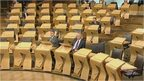 MSPs quiz the transport minister and the health secretary