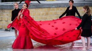 An opera singer performs during a ceremony commemorating World War One at the town of Nieuwpoort in Belgium