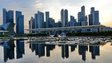 A general view of the financial district skyline is reflected in a pond in Singapore
