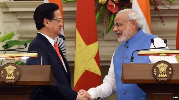 Vietnamese Prime Minister Nguyen Tan Dung and his Indian counterpart, Narendra Modi, shake hands after meeting in Delhi in October 2014