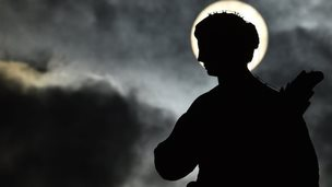 A statue in silhouette at St Peter's square ahead of the general audience of Pope Francis at the Vatican