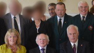 Elaine Hampton (L), Robert Graham, Stephen McAlister, Billy Allen and Gordon Knowles (R) pictured with Irish President Michael D Higgins